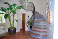 Spiral staircase located in this private intracoastal community home